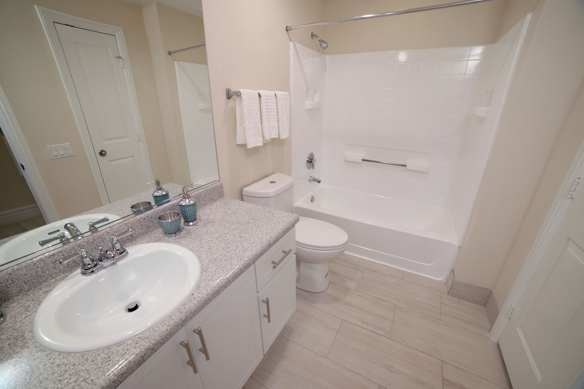 Aliso Viejo Apartments-Aventine Apartments Bathroom with Gorgeous Lighting, a Large Shower and Tub Area, and Spacious Vanity Area