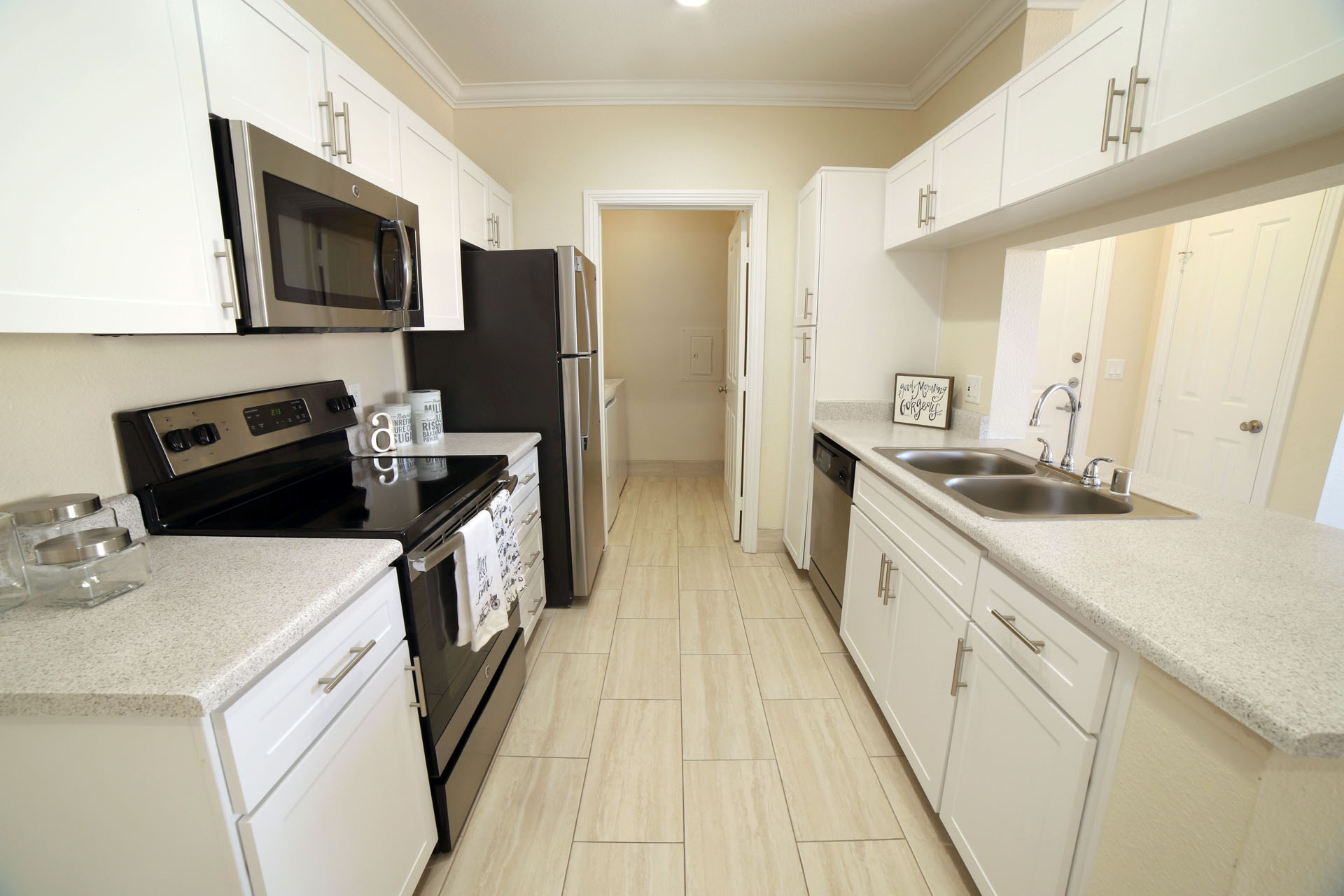 Aliso Viejo Apartments for Rent-Aventine Apartments Kitchen with Matching Appliances, White Cabinets, and Tons of Counter Top Space