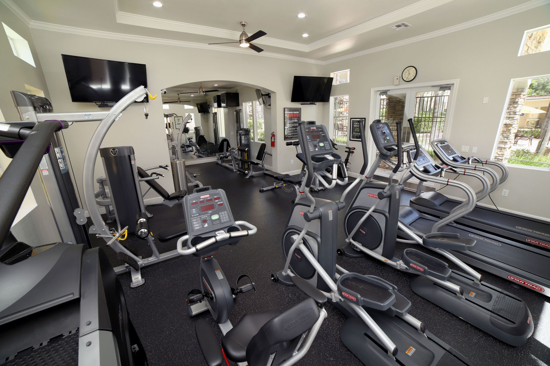 Aliso Viejo CA Apartments-Aventine Apartments Fitness Center with Cardio Machines, Weights, and TVs